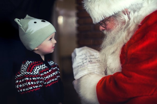 child looking at Santa Claus
