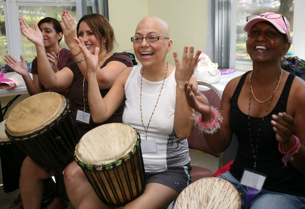 women drumming at Faces of Courage Cancer Camp